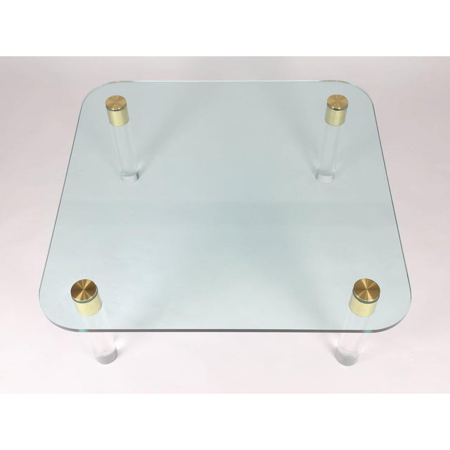 """On sale! Marked down from $3750. Elegant cocktail table features 3/4""""-thick square glass top with rounded corners..."""