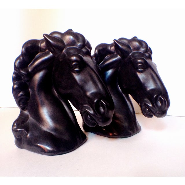 These stylish black stallion Mid-Century bookends would add elegance and swank to any bookshelf. Any book would be lucky...