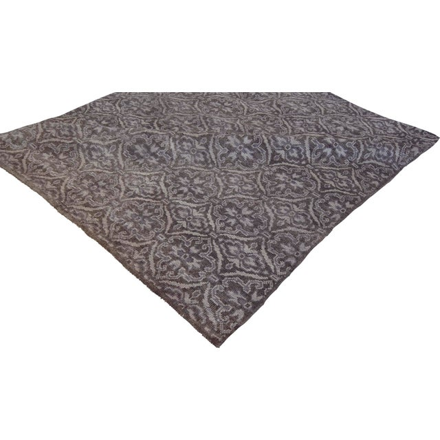 Handwoven in Kashmir, this beautiful modern rug features a soothing dark gray color field and a decorative design.100%...