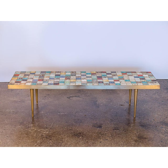 California Modern Tile-Top Brass Coffee Table. Bright tile-top surface consists of multi-colored glazed tiles in different...