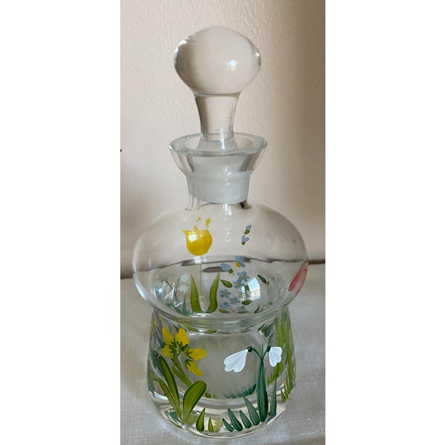 This is a sparkling crystal perfume bottle with stopper. The bottle is enameled (hand painted) with spring flowers. The...