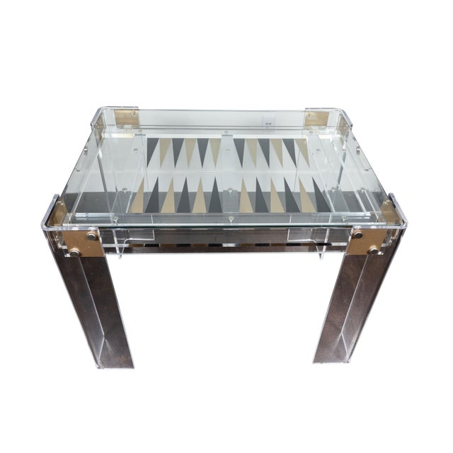 Chic lucite backgammon table, circa 1980's in the manner of Charles Hollis Jones. Table has a removable glass top and...