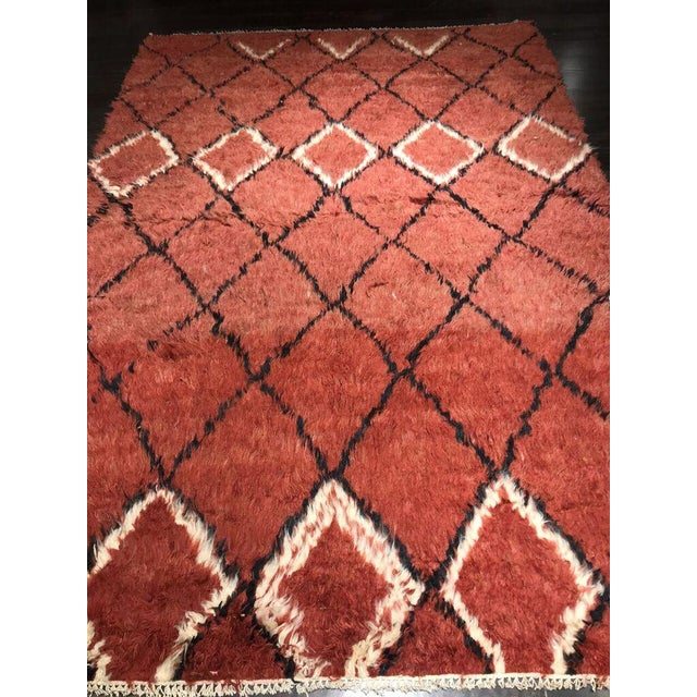 Fabulous red and black Azilal rug ready to spice up any bedroom, room, or office.
