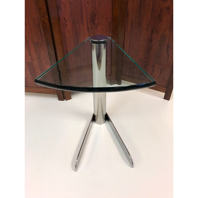 Cantilevered side table manner of Karl Springer. Glass top with chrome frame.