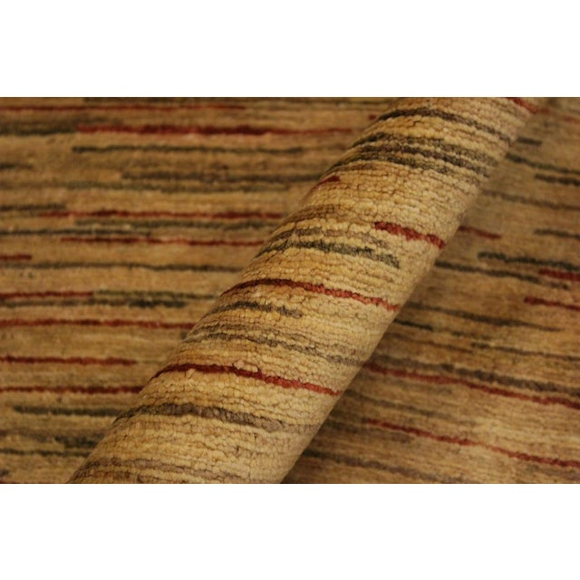 With strict standards of craftsmanship and quality of materials used this modern inspired hand knotted Gabbeh rug is a...