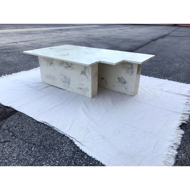 Uniquely shaped post-modern geometric shaped marble coffee table. The jagged square edging is just rad and totally one-of-...