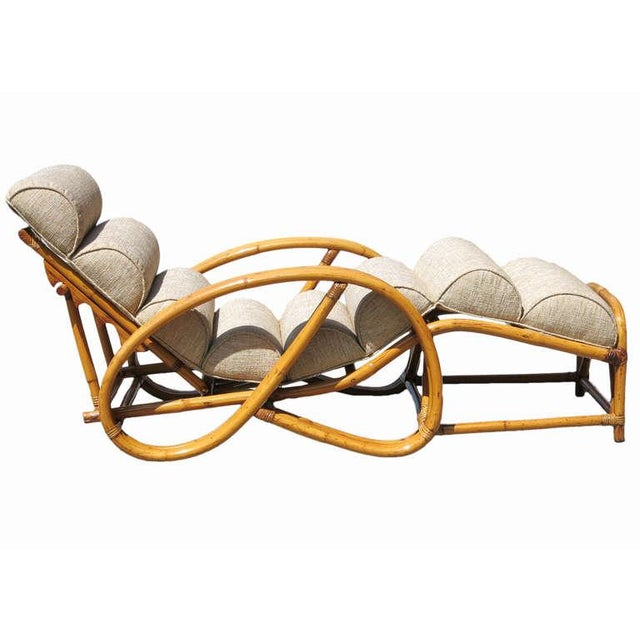 Vintage 1950 three strand pretzel rattan lounge chair with a fully adjustable back in the style of Paul Frankl. Custom...