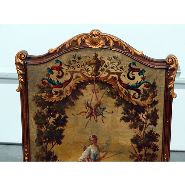 Regency Style Oil Panted screen in a wooden frame with gilt accents.
