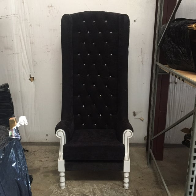 Regal black throne chair. A perfect statement piece for your space.