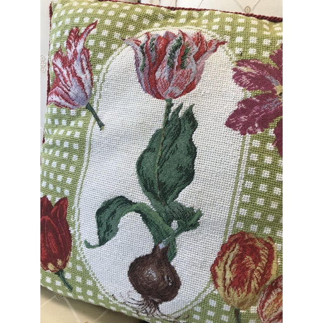 Unique upholstered needlepoint pillow in green and pink of a tulip with bulb and other blooming flowers. The piece was...