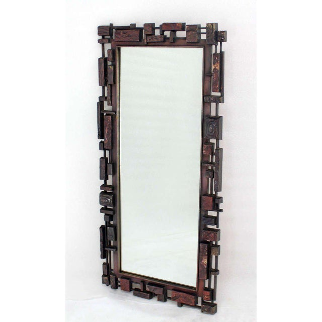 Very nice design mid century modern city scape style molded frame mirror.