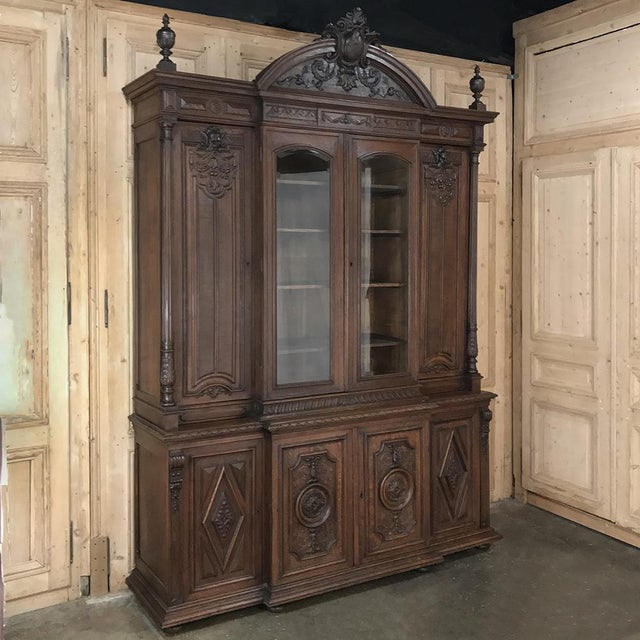 19th Century French Renaissance Grand Bookcase is a study in classical architecture rendered on a larger-than-life scale...