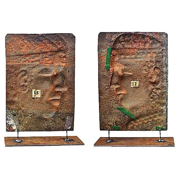 Peruvian vintage copper silloutte reliefs of a man and a woman on stands.