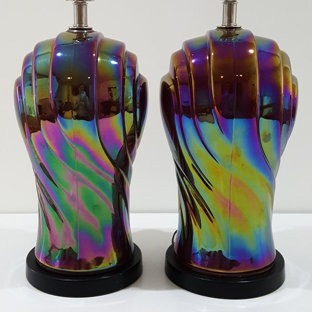 A pair of late 1970s / early 1980s heavily iridized streamline modern glass lamps. The lamps exhibit a combination of 70s...