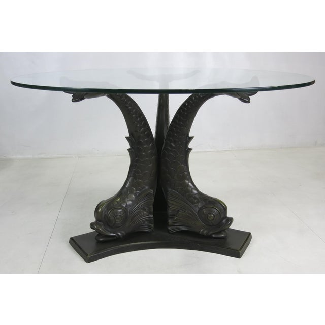 Fabulous patinated bronze Tripartite Dining Table with beautifully detailed Venetian Dolphin supports. The glass top rests...