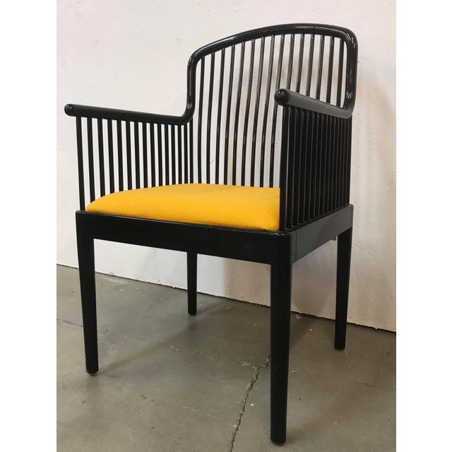 """Offering an exceptional set of 14 """"Andover"""" black lacquered contoured spindle framed dining chairs. Yellow seat..."""