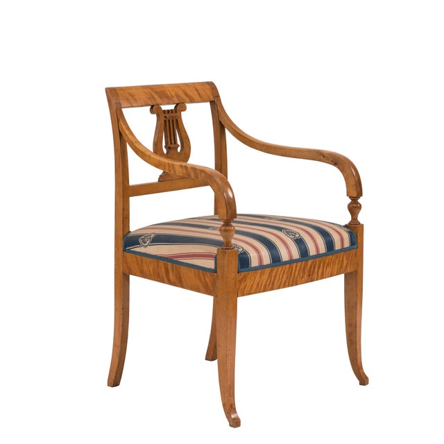 Swedish Biedermeier style (19/20th Cent) birch arm chair with lyre carved back and blue and red stripe upholstery