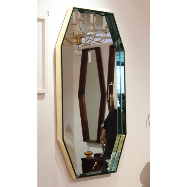 Stunning 1960s blue glass with solid brass frame octagonal mirror model #2355 by Fontana Arte. The mirror can be hung...