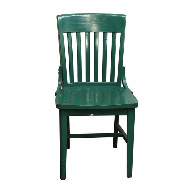 This old chair has been painted green and is in good condition.