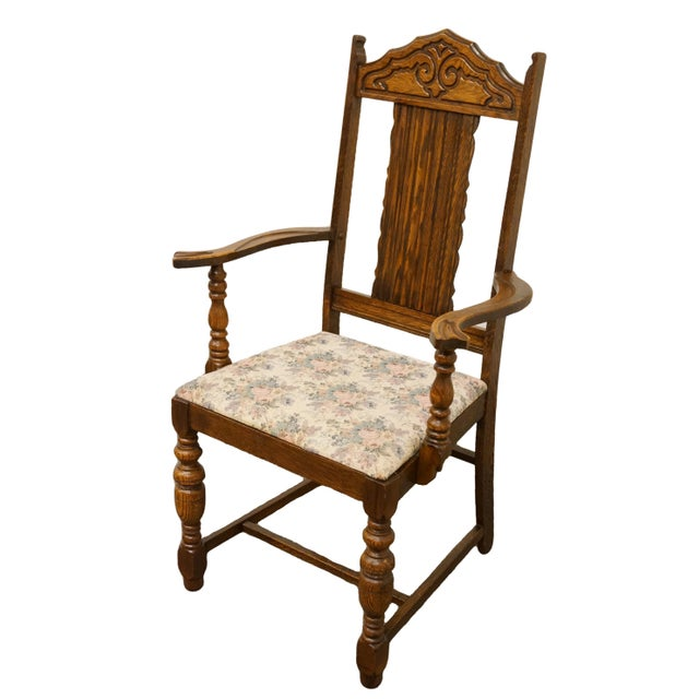 This is an antique Gothic Revival style dining chair. The piece is from the  1920s - 1920s Antique Gothic Revival Style Jacobean Dining Chair Chairish