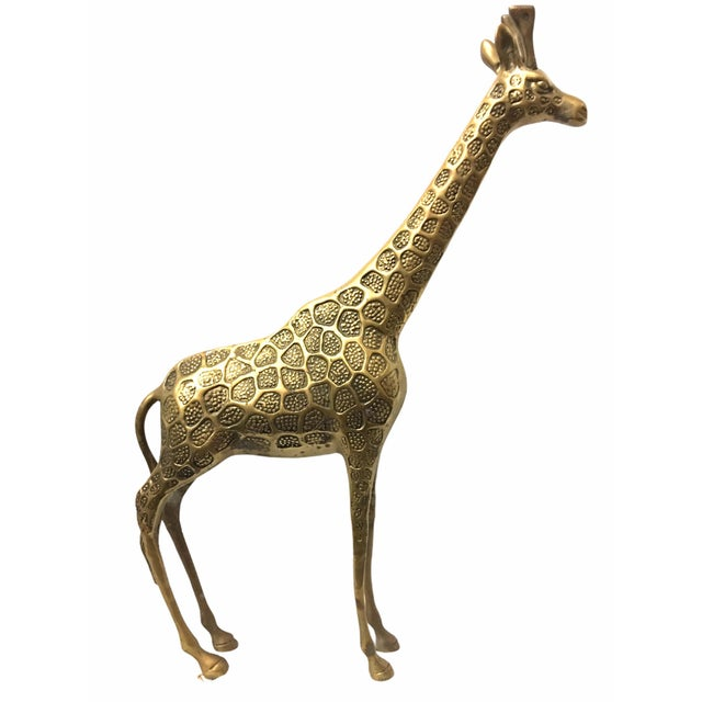 Lovely vintage giraffe figurine. This piece constructed of brass features beautiful detail in a lightly patina gold tone.