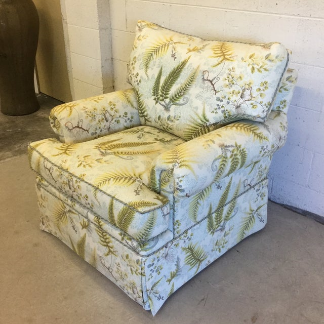 Beautiful and calming fern pattern cotton upholstery adorns this rocking swivel, oversized club chair. Ready for you to...