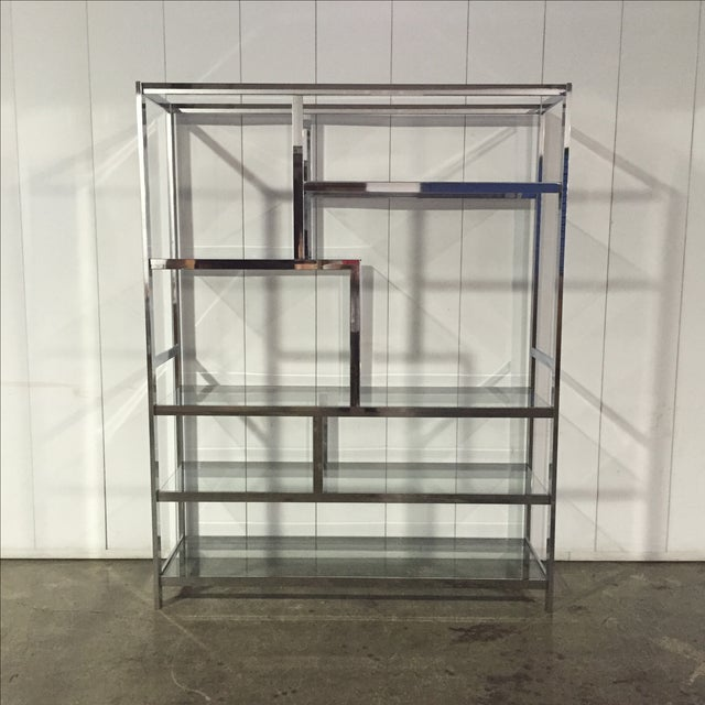 This beautiful Milo Baughman chrome & glass etagere sells for close to 3000$ at fine furniture retailers. A rare and...