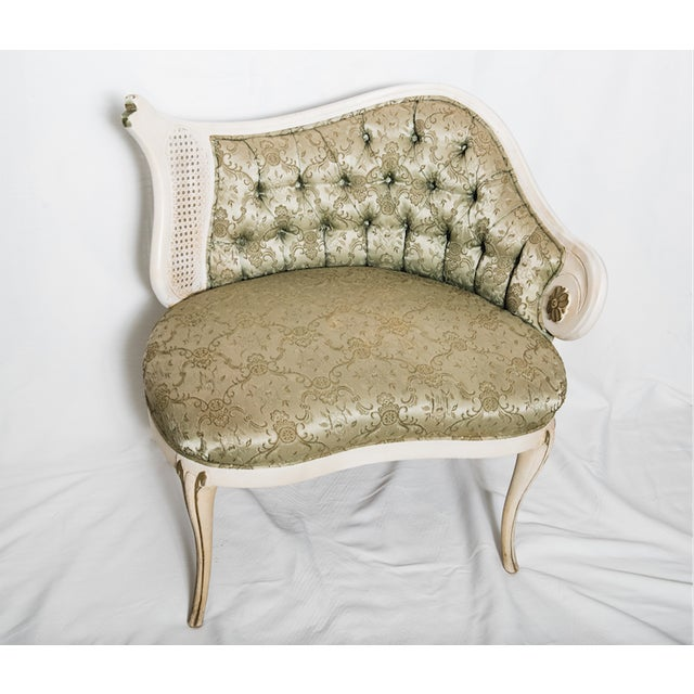 A gorgeous rococo revival chair with tufting and caning. Lovely curves on this solid piece. Minor wear to finish,...