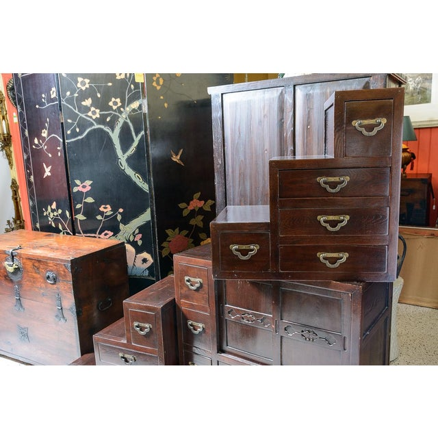 """Beautiful Japanese """"step"""" chest in three sections with drawers and sliding door compartment. Some carving on the doors."""