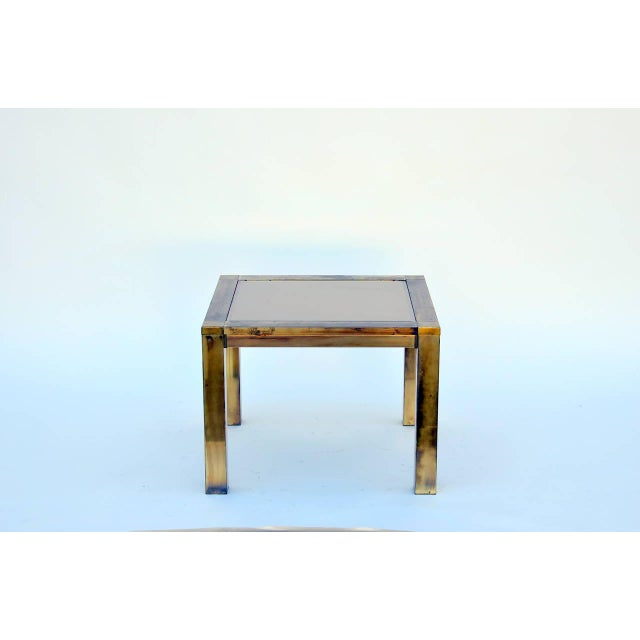 This listing is for a French 1960's Patinated Brass and Bronze Mirrored Side Table. It is in good condition!