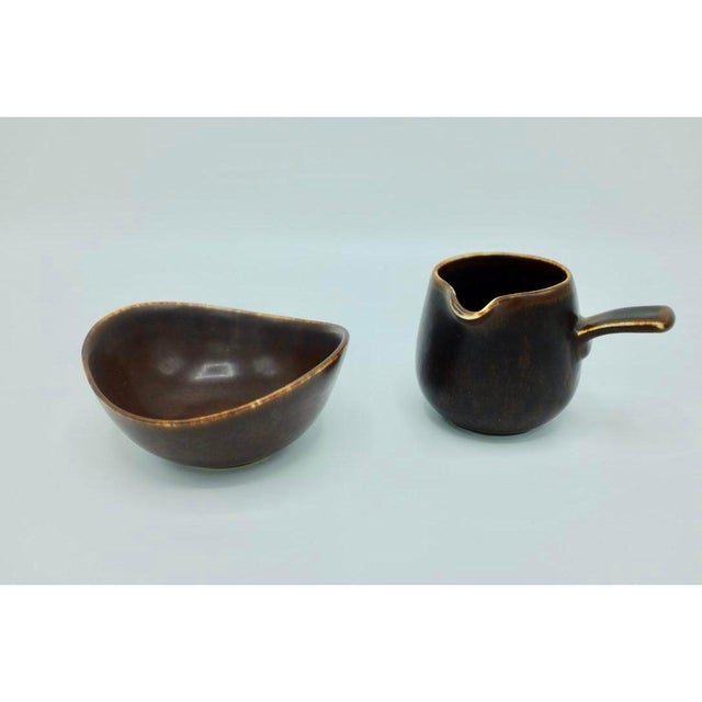 "Charming set of ceramic creamer and bowl by Gunnar Nylund, stamped ""GN US"" at the bottom and in very good condition...."