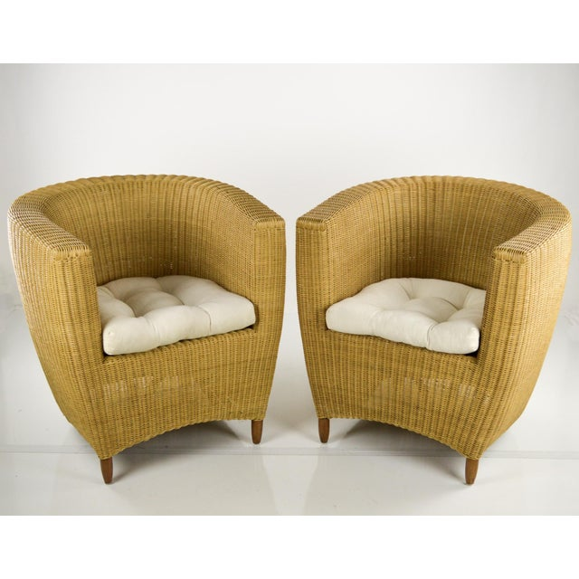 A great pair of vintage modern tub chairs, made of real wicker (not the plastic all-weather material) These are indoor...