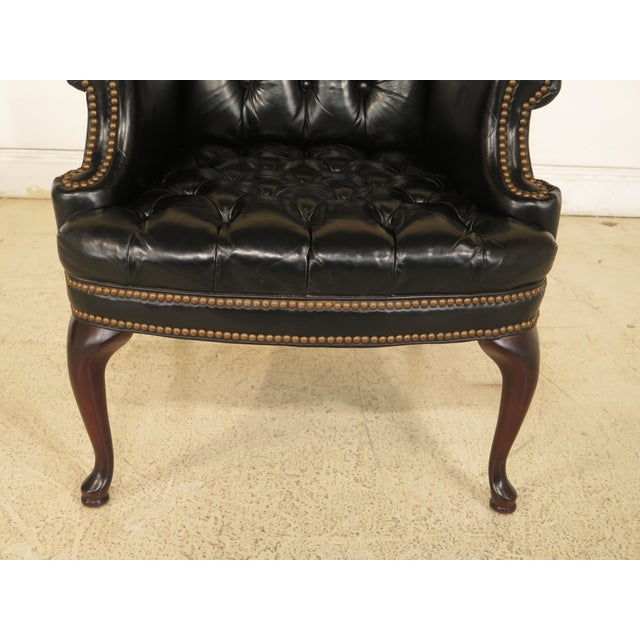 English Tranditional Black Tufted Leather Wing Chair and Ottoman For Sale - Image 4 of 13