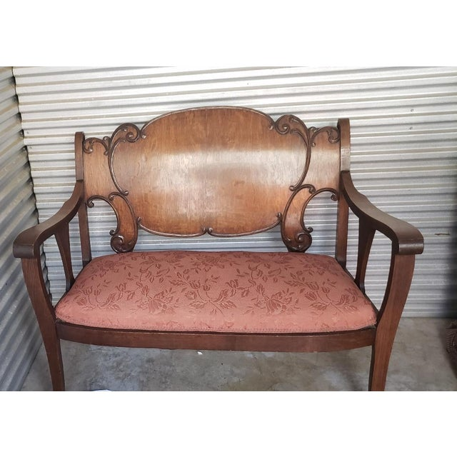 1950 Solid Wood Antique Vintage Love Seat ( Setee). Beautiful Ornate love seat with a design on the back of the seating....