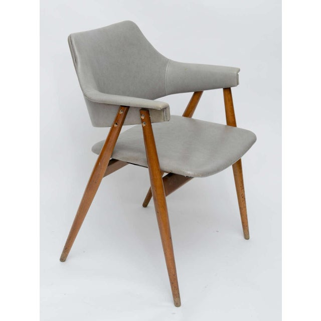 Beautiful MCM vinyl and wood chair from the 50s attributed to Paul McCobb.