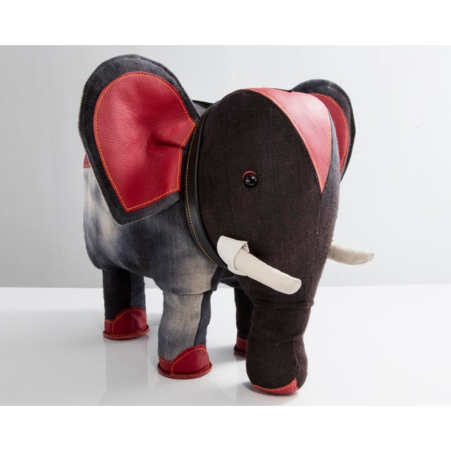 """""""Therapeutic Toy"""" Elephant in black jute and red, black, and white leather. Designed and made by Renate Müller, Germany,..."""