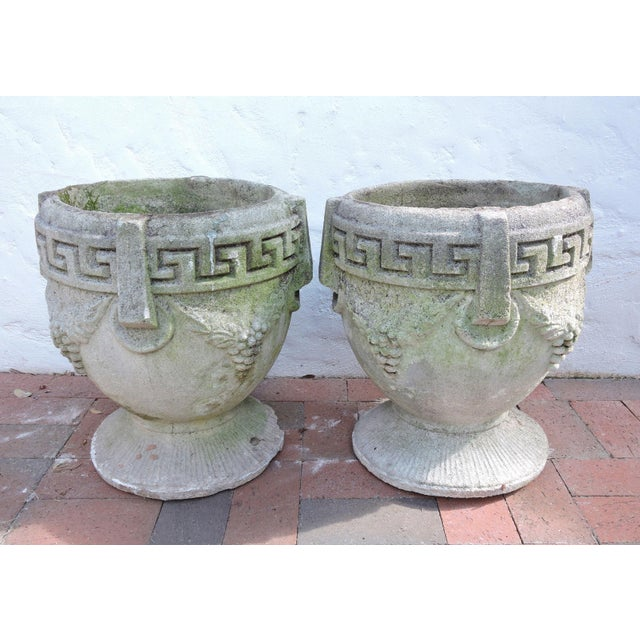 A pair of neoclassical cement garden planters - Greek key pattern with grapes on either side and mock handles. Beautifully...