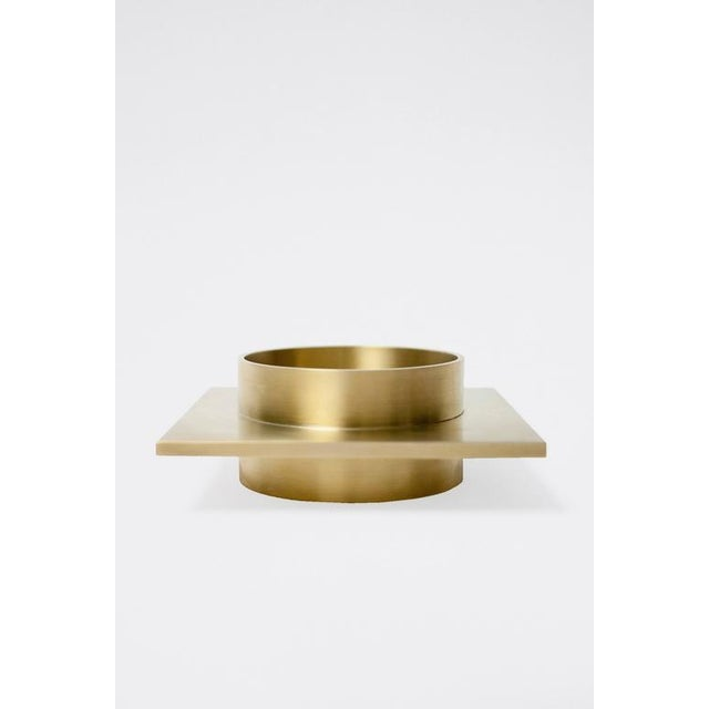 This contemporary dish made of brushed brass is part of the Orphan Work brand and can be used as an table top object....