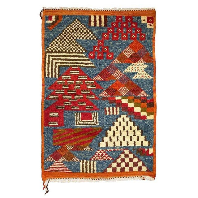 One-of-a-kind hand woven rug in the semi- thick pile style of the Atlas. It is marked by simple Berber designs and motifs...