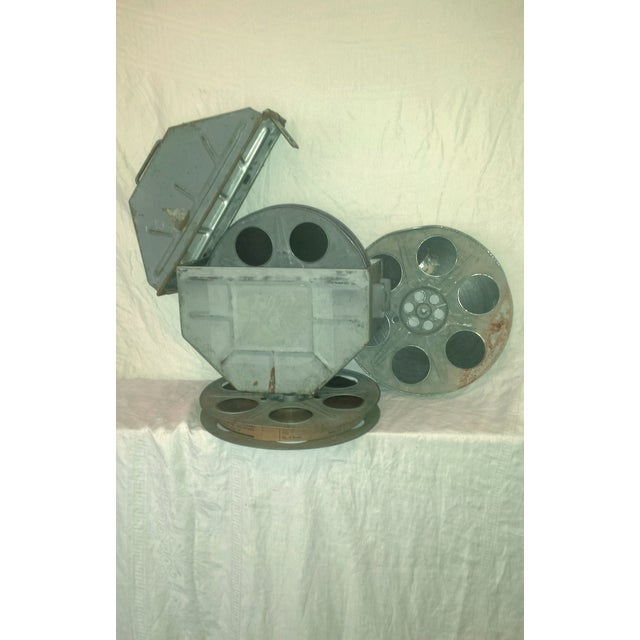 Vintage 1960 Movie Reel Pictures 3-Reels of 35mm Film in this Industrial looking metal Shipping Canister. Three reels full...