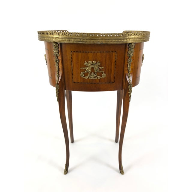 An exquisitely made kidney shaped mahogany side table or nightstand having ebony inlay, two dovetailed drawers, handsome...