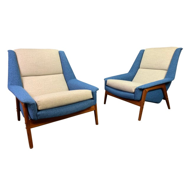"Here is an exquisite set of two scandinavian modern ""Profil"" easy chairs designed by Folke Ohlsson and manufactured by Dux..."