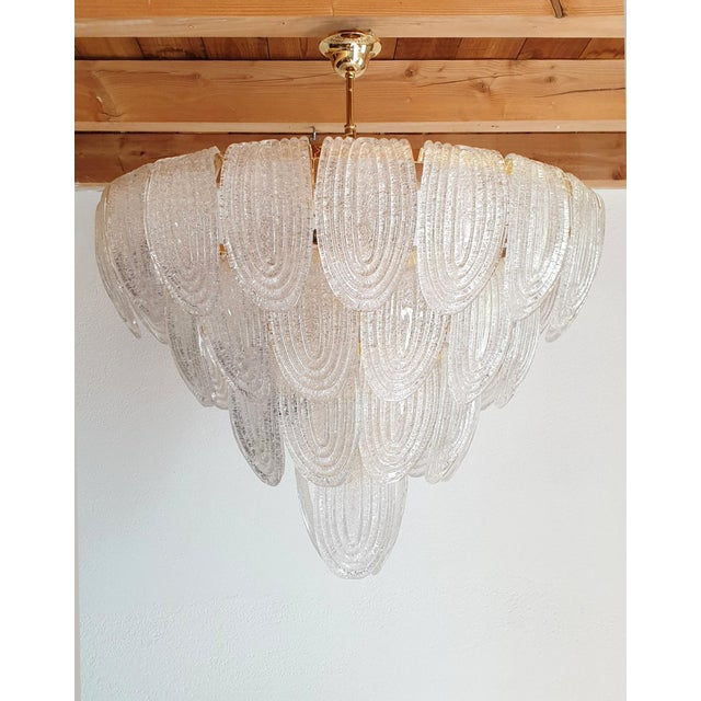 Large Mid-Century Modern translucent & textured Murano glass chandelier, with gold plated frame. Two available. Can be...