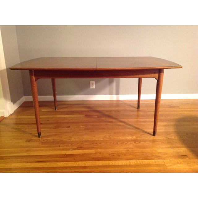 A circa 1960s dining table By John Keal for Brown Saltman. Great shape and nice simple lines would make this a wonderful...