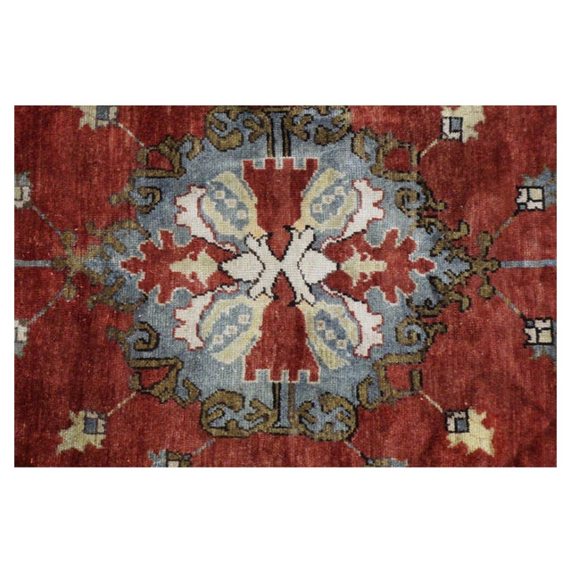 This beautiful Rug is hand made, 100% wool pile, made in Turkey, Ushak region. It features a pattern in a vibrant...