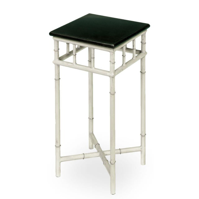 Estimated Retail Price: $297. This diminutive side table is made from metal and marble. Its base features a dirty white...