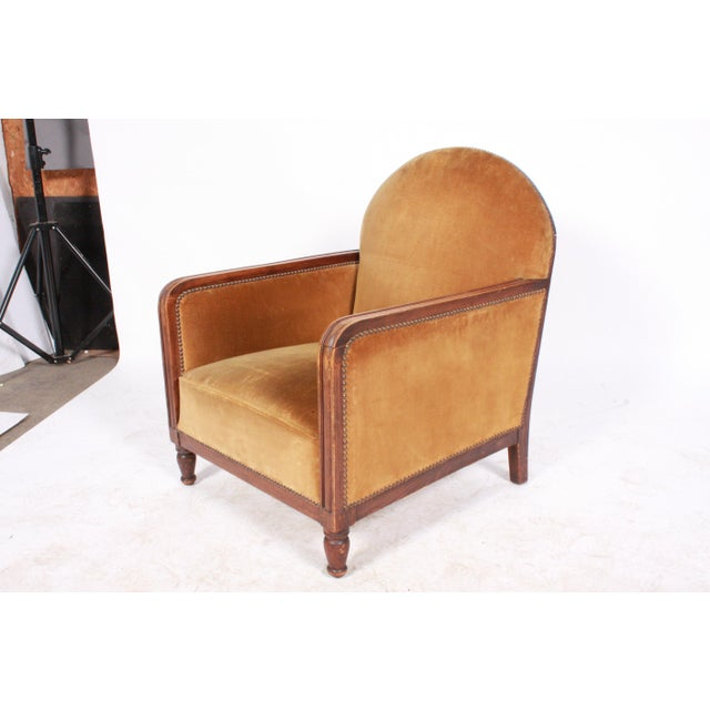 Pair of 1940s Art Deco-Style club chairs from Belgium featuring rounded backs, enclosed sides, covered in vintage gold...