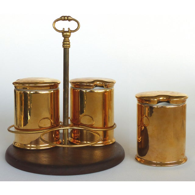 Offered for sale is an unusual set of Porcelaine de Paris Gold Lustre Lidded Condiment Jars and Stand, The jars are fully...