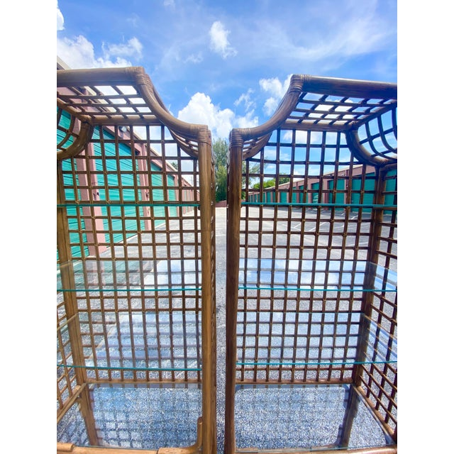 Fabulous pair of bamboo pagoda etagere. Beautiful bamboo grid work on the back and sides. Glass shelves. Acquired from a...