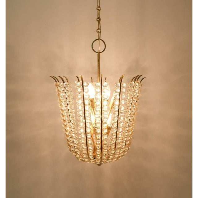 Stunning fully restored chandelier by Bakalowits composed of hundreds of crystals and delicate brass hardware. It's in...